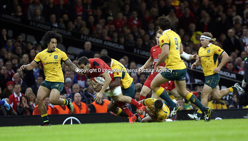 Pictured: Sam Warburton of Wales (with ball) is tackle by Sekope Kepu of Australia. Saturday 08 November 2014<br /> Re: Dove Men Series rugby, Wales v Australia at the Millennium Stadium, Cardiff, south Wales, UK.