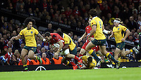 Pictured: Sam Warburton of Wales (with ball) is tackle by Sekope Kepu of Australia. Saturday 08 November 2014<br />
