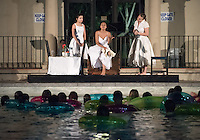 "Occidental College students Amy Weinstein '19, Rachel Goodman '19 and Dyoni Isom '19 perform in ""Out at Sea"" by Slawomir Mrozek, directed by Jamie Angell at Taylor Pool on April 1, 2016. The audience was invited to watch the play from the pool itself with inner tubes provided.<br /> (Photo by Marc Campos, Occidental College Photographer)"