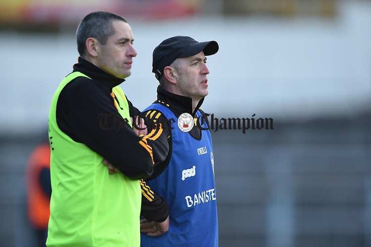 Ballyea coach Fergal Hegarty and manager Robbie Hogan on the sideline during the Munster Club hurling final against Glen Rovers at Thurles. Photograph by John Kelly.