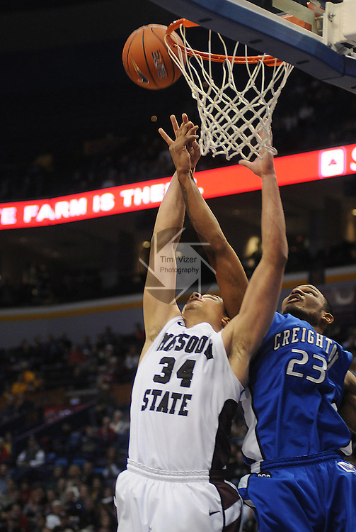 March 5,  2011        Missouri State Bears forward Kyle Weems (34) and Creighton Bluejays forward Wayne Runnels (23) jump for a second half rebound.  Missouri State defeated Creighton 60-50 in the first semifinal game of the NCAA Missouri Valley Conference Men's Basketball Tournament onSaturday March 5, 2011 at the Scottrade Center in downtown St. Louis.