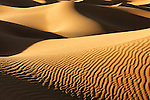 Sahara desert sand dunes with dark shadows at Erg Lihoudi, Morocco.