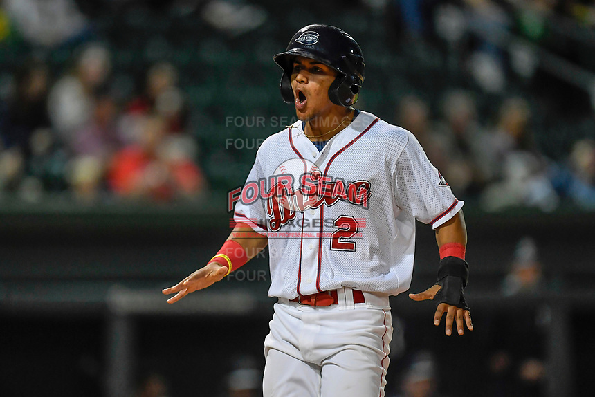 Shortstop Santiago Espinal (2) of the Greenville Drive shouts as he scores a run in Game 3 of the South Atlantic League Southern Division Playoff against the Charleston RiverDogs on Saturday, September 9, 2017, at Fluor Field at the West End in Greenville, South Carolina. Greenville won, 5-0, winning the division championship two games to one. (Tom Priddy/Four Seam Images)