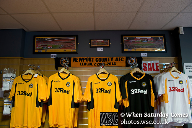 Newport County 1 Exeter City 1, 16/03/2014. Rodney Parade, League Two. Newport County finally return to the Football league after years of turmoil but a poor run of results has dented hopes of reaching the play-offs while Exeter City battle relegation. The Newport County club shop selling the latest home and away shirts. Photo by Simon Gill