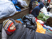 "USA. New York City. Occupy Wall Street (OWS) is a people-powered movement that began on September 17, 2011 in Liberty Square in the Wall Street financial district of Manhattan. The protesters have created a small campsite at the Zuccotti Park site. OWS and has spread to over 100 cities in the United States and actions in over 1,500 cities globally. OWS is mainly protesting social and economic inequality, corporate greed, corruption and influence over government—particularly from the financial services sector—and lobbyists.  It is fighting back against the corrosive power of major banks and multinational corporations over the democratic process, and the role of Wall Street in creating an economic collapse that has caused the greatest recession in generations. The protesters' slogan, ""We are the 99%"", refers to the difference in wealth and income growth in the U.S. between the wealthiest 1% and the rest of the population. OWS aims to expose how the richest 1% of people are writing the rules of an unfair global economy that is foreclosing on our future. OWS has being organized using a non-binding consensus based collective decision making tool known as a ""people's assembly"". Men sleeping. 22.10.2011 © 2011 Didier Ruef"