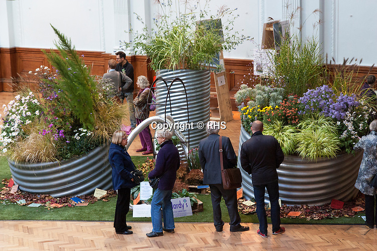 Visitors look at the Cityscapes Nursery Installations at the RHS London Shades of Autumn Show 2013.