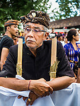 13 JULY 2016 - UBUD, BALI, INDONESIA:  A man at the mass cremation in Ubud Wednesday. Local people in Ubud exhumed the remains of family members and burned their remains in a mass cremation ceremony Wednesday. Almost 100 people will be cremated and laid to rest in the largest mass cremation in Bali in years this week. Most of the people on Bali are Hindus. Traditional cremations in Bali are very expensive, so communities usually hold one mass cremation approximately every five years. The cremation in Ubud will conclude Saturday, with a large community ceremony.     PHOTO BY JACK KURTZ