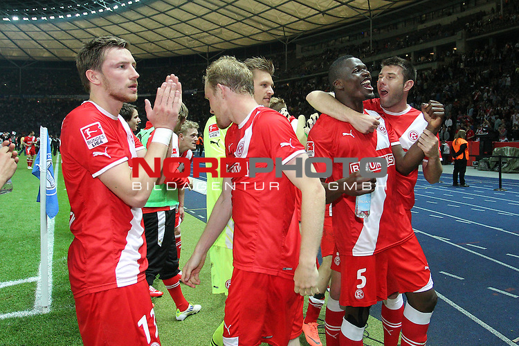 10.05.2012, Olympiastadion, Berlin, GER, 1.FBL, Hertha BSC Berlin vs Fortuna Duesseldorf, im Bild<br /> von links:  Michael Ratajczak (Torwart D&uuml;sseldorf), Assani Lukimya-Mulongoti (D&uuml;sseldorf #5) und Juanan (D&uuml;sseldorf #3) feiern<br /> <br /> // during the 1.FBL Relegation, Hertha BSC Berlin vs Fortuna Duesseldorf on 2012/05/10, Olympiastadion, Berlin, Germany. Foto &copy; nph / Mueller *** Local Caption ***