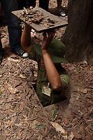 Ho Chi Minh city<br /> , Vietnam - 2007 File Photo -<br /> <br /> <br />  soldier shows  trap door to  Cu Chi tunnels.<br /> <br /> <br /> <br /> photo : James Wong-  Images Distribution
