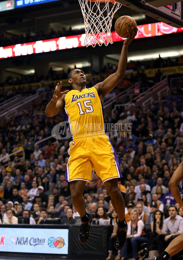 Jan. 30, 2013; Phoenix, AZ, USA: Los Angeles Lakers forward Metta World Peace goes up for a layup in the first quarter against the Phoenix Suns at the US Airways Center. Mandatory Credit: Mark J. Rebilas-