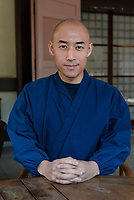 """Priest Matsumoto Shoukei. """"Temple Morning"""" cleaning session. Komyoji Temple, Kamiyacho, Tokyo, Japan, April 13, 2019. Matsumoto Shoukei is the author of A Monk's Guide to a Clean House and Mind (Penguin). He hold periodic cleaning sessions at his temple in Tokyo's Kamiyacho district."""