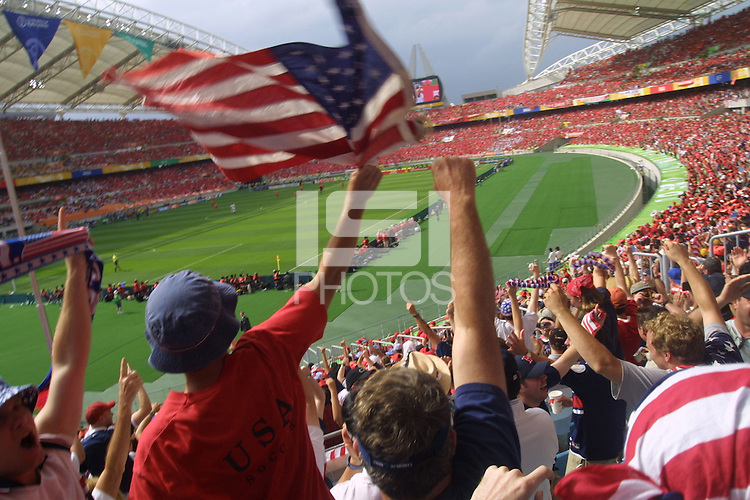 US Soccer supporters celebrate the first goal of the United States national team in their first round World Cup match against South Korea on Monday June 10th, 2002 in Daegu, South Korea. The USA national tied South Korea 1-1.