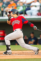 Jose Iglesias #10 of the Pawtucket Red Sox follows through on his swing against the Charlotte Knights at Knights Stadium on August 11, 2011 in Fort Mill, South Carolina.  The Red Sox defeated the Knights 3-2.   (Brian Westerholt / Four Seam Images)