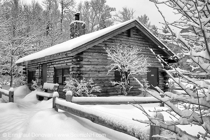Log cabin restroom at Lincoln Woods Trailhead in Lincoln, New Hampshire USA during the winter months