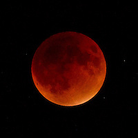 NWA Democrat-Gazette/BEN GOFF @NWABENGOFF<br /> The full moon appears red inside the umbra, or center, of the Earth's shadow at full eclipse on Sunday Sept. 27, 2015 as seen from the campus of Northwest Arkansas Community College in Bentonville. The eclipse was the rare concurrence of a lunar eclipse or 'blood moon,' and lunar perigee, the point in the moon's elliptical orbit when it is closest to earth. In recent years the term 'supermoon' has been used to describe a perigee full moon. The last supermoon eclipse occurred in 1982 and the phenomena will not happen again until 2033.