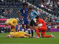 Women's Olympic Football match France v Sweden on 3.8.12...Lotta Schelin of Sweden and Sarah Bouhaddi of France after colliding, during the Women's Olympic Football match between France v Sweden at Hampden Park, Glasgow...............
