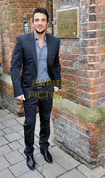 Peter Andre arrives at the Oxford Union prior to addressing the Student Debating Society, Oxford University, England..January 31st 2012.full length black blue grey gray suit shirt  stubble facial hair.CAP/JIL.©Jill Mayhew/Capital Pictures
