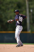 GCL Yankees 2 second baseman Yonauris Rodriguez (89) warmup throw to first during the first game of a doubleheader against the GCL Pirates on July 31, 2015 at the Pirate City in Bradenton, Florida.  GCL Pirates defeated the GCL Yankees 2 2-1.  (Mike Janes/Four Seam Images)