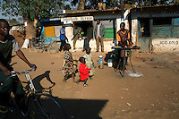 RImages MPHANDULA, MALAWI - AUGUST 20: Unidentified children walk at a market place on August 20, 2006 in Mphandula village, about 30 miles outside Lilongwe, Malawi. Mphandula is a poor village in Malawi, without electricity or clean water. Nobody owns a car or a mobile phone. Most people live on farming. About 7000 people reside in the village and the chief estimates that there are about five-hundred orphans. Many have been affected by HIV/Aids and many of the children are orphaned. A foundation started by Madonna has decided to build an orphan center in the village through Consol Homes, a Malawi based organization. Raising Malawi is investing about 3 million dollars in the project and Madonna is scheduled to visit the village in October 2006. Malawi is a small landlocked country in Southern Africa without any natural resources. Many people are affected by the Aids epidemic. Malawi is one of the poorest countries in the world and has about 1 million orphaned children. (Photo by Per-Anders Pettersson)
