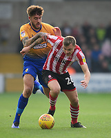 Lincoln City's Harry Anderson shields the ball from Mansfield Town's Ryan Sweeney<br /> <br /> Photographer Chris Vaughan/CameraSport<br /> <br /> The EFL Sky Bet League Two - Lincoln City v Mansfield Town - Saturday 24th November 2018 - Sincil Bank - Lincoln<br /> <br /> World Copyright &copy; 2018 CameraSport. All rights reserved. 43 Linden Ave. Countesthorpe. Leicester. England. LE8 5PG - Tel: +44 (0) 116 277 4147 - admin@camerasport.com - www.camerasport.com