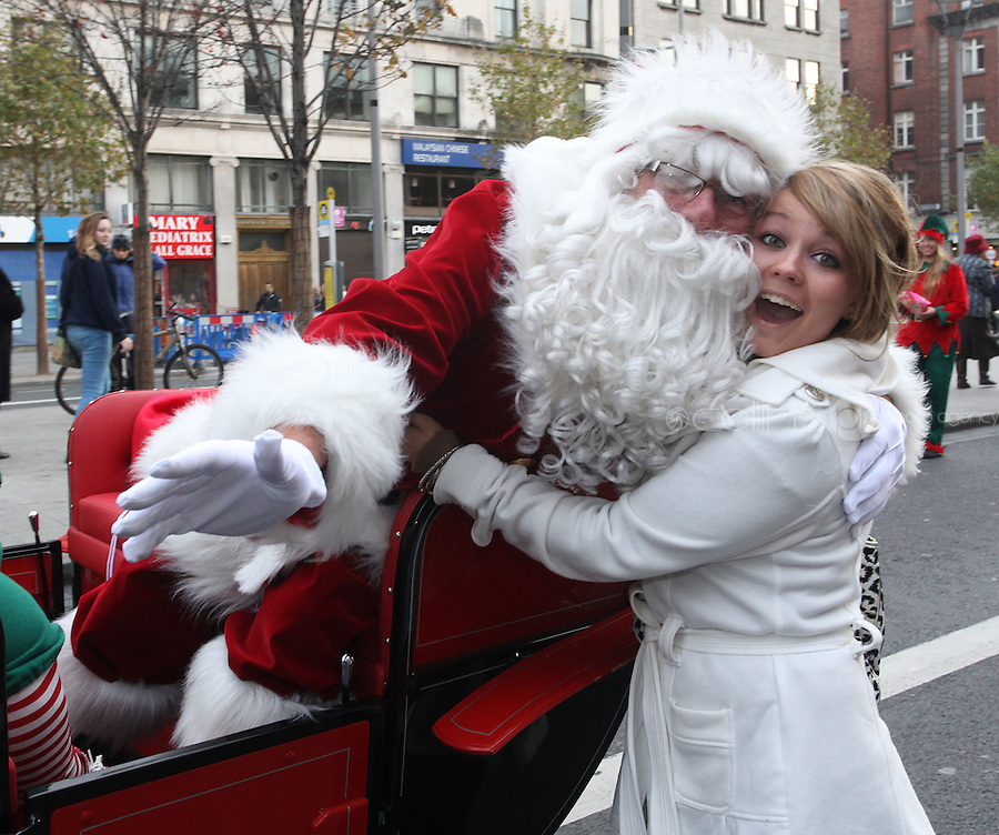 ****NO FEE PIC ******.19/11/2011.Santa Claus is greeted by Aideen Duffy from Delvin Westmeath during a Christmas Parade.at the opening of Santa's Playland in The Ambassador Theatre,Dublin.One of this Christmas' biggest events is coming!  Santa's Playland takes up residence at The Ambassador Theatre in preparation for this year's festive season.  The spectacular event opens on Saturday 19 November and runs until Friday 23 December. Santa's Playland will see children transported to a magical Christmas paradise.On entering Santa's Playland children will be treated to a special Christmas play time.  The Play Area is full of Christmas treats with bouncy castles, slides and Christmas displays..Photo: Gareth Chaney Collins