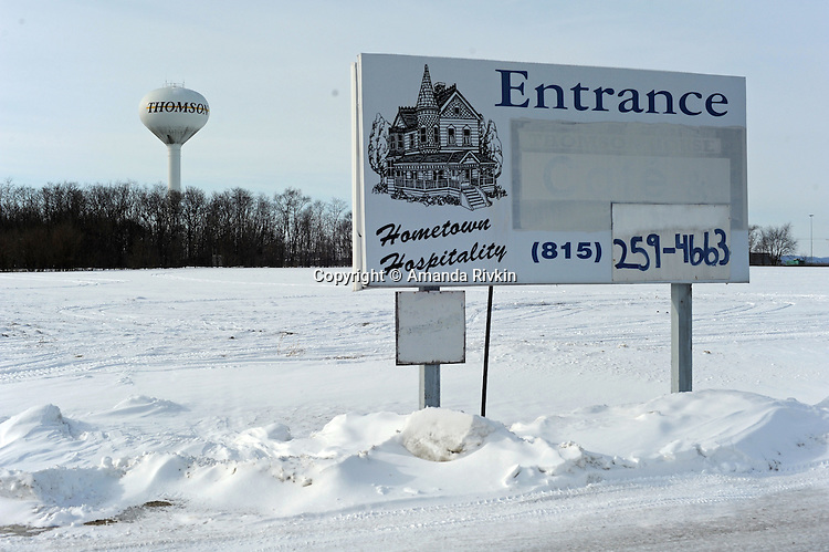 A sign for a development that never happened is seen on One Mile Road outside the Thomson Correctional Center in tiny Thomson, Illinois on January 4, 2010. Thomson Correctional Center was an empty prison facility outside the town of 600 that is being revamped and rehabilitated in preparation for the possible incoming influx of prisoners from the U.S. detention facility for prisoners of the War on Terror currently held in Guantanamo Bay, Cuba.