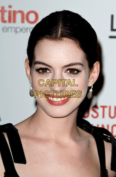 "ANNE HATHAWAY.The West Coast premiere of ""Valentino: The Last Emperor"" at the Los Angeles County Museum of Art (LACMA), Los Angeles, California, USA..April 1st, 2009.headshot portrait earrings .CAP/ROT.©Lee Roth/Roth Stock/Capital Pictures"