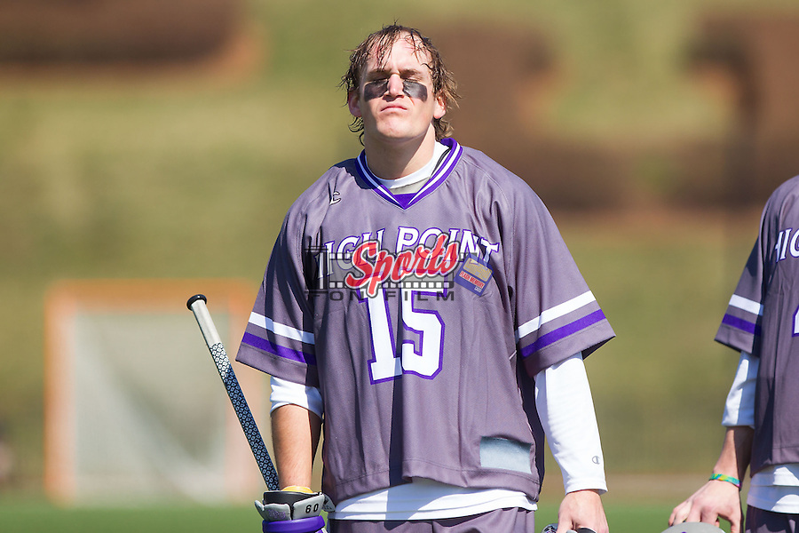 Austin Geisler (15) of the High Point Panthers stands for the National Anthem prior to their game against the UMBC Retrievers at Vert Track, Soccer & Lacrosse Stadium on March 15, 2014 in High Point, North Carolina.  The Panthers defeated the Retrievers 17-15.   (Brian Westerholt/Sports On Film)