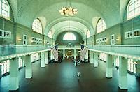 toursits visiting historic Ellis Island building. Immigration, historic, history, New York Harbor. tourists. New York City NY USA.