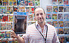 London Super Comic Con<br /> at Design Centre Islington, London, Great Britain <br /> 25th August 2017 <br /> <br /> <br /> <br /> Vincent Zurzolo holds a first edition Sandman comic by Neil Gaiman <br /> <br /> <br /> London Super Comic Con plays host to the latest comics, comic related memorabilia, superheroes and graphic novels fans have a chance to interact with their favourite creators, and  exhibitors showcasing items from comics to Cosplay, original art to toys.<br /> <br /> <br /> <br /> <br /> <br /> <br /> Photograph by Elliott Franks <br /> Image licensed to Elliott Franks Photography Services