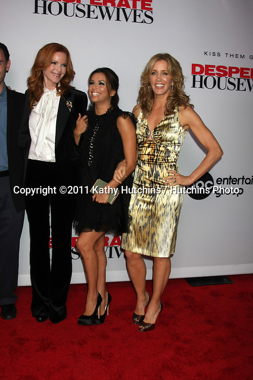 """LOS ANGELES - SEPT 21:  Marcia Cross, Eva Longoria, Felicity Huffman arriving at the """"Desperate Housewives"""" Final Season Kick-Off Party at Wisteria Lane, Universal Studios on September 21, 2011 in Los Angeles, CA"""