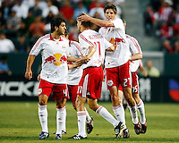 NY Red Bulls defender, Carlos Mendes(4), NY Red Bulls defender, Andrew Boyens(27) and NY Red Bulls forward, John Wolyniec(15) celebrate with NY Red Bulls midfielder, Dave van den Bergh(11) after he scored a goal in the 1st half. Chivas USA  took on the NY Red Bulls on June 28, 2008 at the Home Depot Center in Carson, CA. The game ended in a 1-1 tie.