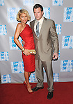 Paris Hilton & Doug REINHARDT at 'AN EVENING WITH WOMEN: Celebrating Art, Music & Equality' held at The Beverly Hilton Hotel in Beverly Hills, California on April 24,2009                                                                     Copyright 2009 Debbie VanStory / RockinExposures