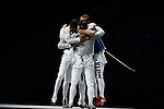 LONDON, ENGLAND - AUGUST 3:  Diego Occhiuzzi of Italy celebrates with his team after defeating Alexy Yakimenko of Russia during the Men's Fencing Team Sabre Bronze and Gold  Medal Final Day 7 of the London 2012 Olympic Games on August 3, 2012 at the Excell Center in London, England. (Photo by Donald Miralle)