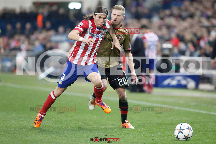Atletico de Madrid´s Filipe Luis (L) and Milan´s Ignazio Abate during 16th Champions League soccer match at Vicente Calderon stadium in Madrid, Spain. March 11, 2014. (ALTERPHOTOS/Victor Blanco)