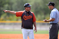 Baltimore Orioles manager Gary Allenson argues a call with umpire Brian Peterson during an extended spring training game against the Tampa Bay Rays at the Charlotte County Sports Park on April 28, 2012 in Port Charlotte, Florida.  (Mike Janes/Four Seam Images)