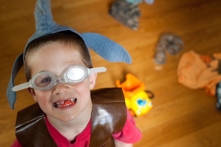 My son, age five, in one of his ensembles: elephant hat, goggles, cowboy vest and chewing gum.