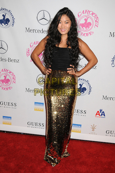Chloe Flower.26th Annual Carousel of Hope Gala held at the Beverly Hilton Hotel, Beverly Hills, .California, USA, 20th October 2012..full length hands on hips gold dress sequined sequin black top  .CAP/ADM/BP.©Byron Purvis/AdMedia/Capital Pictures.