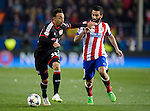 Leverkusen's forward Karim Bellarabi vies with Atletico Madrid's Turkish midfielder Arda Turan during the round of 16 second leg UEFA Champions League football match Atletico de Madrid vs Bayern Leverkusen at the Vicente Calderon stadium in Madrid on March 17, 2015.  PHOTOCALL3000/ DP