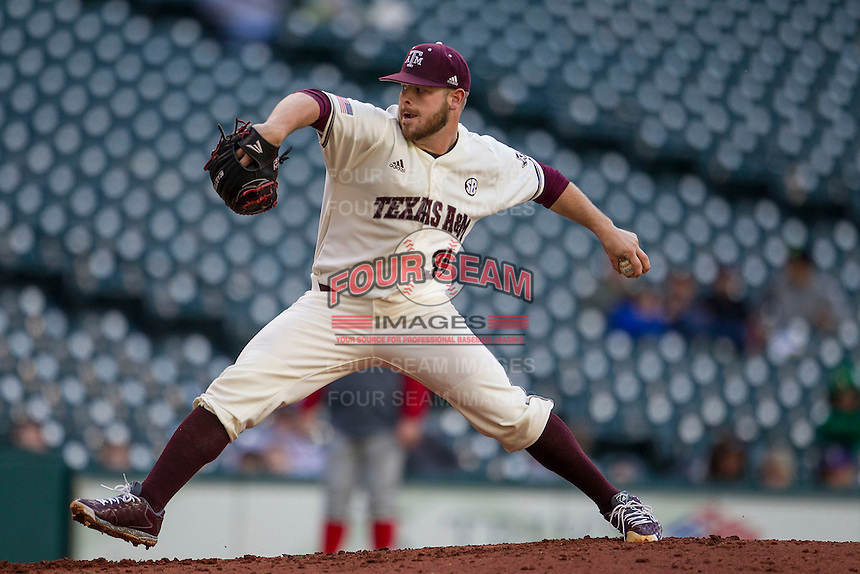 Texas A&M Aggies pitcher A.J. Minter (34) delivers a pitch to the plate during Houston College Classic against the Nebraska Cornhuskers on March 6, 2015 at Minute Maid Park in Houston, Texas. Texas A&M defeated Nebraska 2-1. (Andrew Woolley/Four Seam Images)