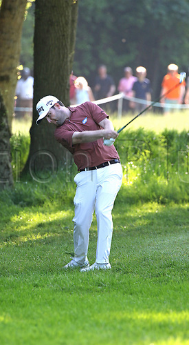 May 25th 2017, Virginia Water, Wentworth, Surrey, England; BMW PGA Championship golf, day 1; Branden Grace of South Africa plays form the right hand rough on the 17th