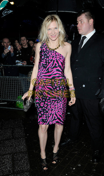 JO WHILEY.The Shockwaves NME Awards 2010 held at Brixton Academy, London, England. .February 24th, 2010.full length pink purple black one shoulder grey gray clutch bag ankle boots pattern print .CAP/CAN.©Can Nguyen/Capital Pictures.