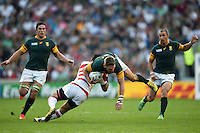 Jean De Villiers of South Africa is tackled by Ayumu Goromaru of Japan. Rugby World Cup Pool B match between South Africa and Japan on September 19, 2015 at the Brighton Community Stadium in Brighton, England. Photo by: Patrick Khachfe / Stewart Communications