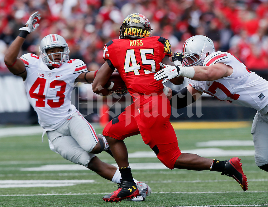 Ohio State Buckeyes defensive lineman Darius Slade (42)attempts to block Maryland Terrapins running back Brandon Ross (45)  in the second quarter of their game at Byrd Stadium in College Park, Maryland on October 4, 2014. (Columbus Dispatch photo by Brooke LaValley)