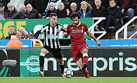 Liverpool's Mohamed Salah battles with Newcastle United's Javi Manquillo<br /> <br /> Photographer Rich Linley/CameraSport<br /> <br /> The Premier League -  Newcastle United v Liverpool - Sunday 1st October 2017 - St James' Park - Newcastle<br /> <br /> World Copyright &copy; 2017 CameraSport. All rights reserved. 43 Linden Ave. Countesthorpe. Leicester. England. LE8 5PG - Tel: +44 (0) 116 277 4147 - admin@camerasport.com - www.camerasport.com