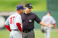 Base umpire Jorge Teran explains a call at first base to Hagerstown Suns manager Tripp Keister (17) during the South Atlantic League game against the Kannapolis Intimidators at CMC-Northeast Stadium on May 16, 2013 in Kannapolis, North Carolina.  The Suns defeated the Intimidators 10-7.   (Brian Westerholt/Four Seam Images)