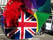 Feather boa, Union Flag and Rainbow coloured umbrella - at London Pride 2008.