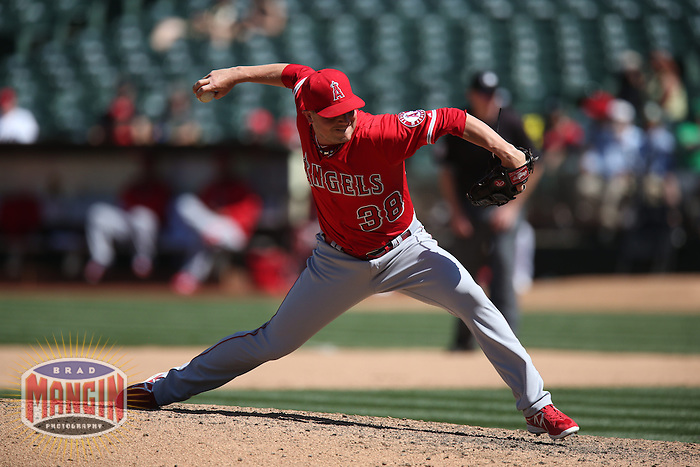 OAKLAND, CA - APRIL 30:  Joe Smith #38 of the Los Angeles Angels pitches against the Oakland Athletics during the game at O.co Coliseum on Thursday, April 30, 2015 in Oakland, California. Photo by Brad Mangin