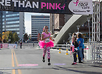 Participants cross the finish line during the Susan G. Koman Race for the Cure in Reno, Nevada on Sunday, October 15, 2017.