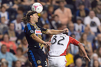 Jeff Parke (31) of the Philadelphia Union goes up for a header with Andrew Wiedeman (32) of Toronto FC. The Philadelphia Union defeated Toronto FC 1-0 during a Major League Soccer (MLS) match at PPL Park in Chester, PA, on October 5, 2013.